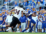 BROOKINGS, SD - SEPTEMBER 12:  Trevor Wesley #80 from South Dakota State is brought down by Josh Thomton #25 and Mike Needham #34 from Southern Utah in the first half of their game Saturday night in Brookings. (Photo by Dave Eggen/Inertia)