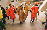"Two Ivory Coast supporters help the ""Elephant of Ivory Coast""  to his seat at Soccer City before the FIFA World Cup first round match between Ivory Coast and Brazil at Soccer City in Johannesburg, South Africa on Sunday, June 20, 2010."