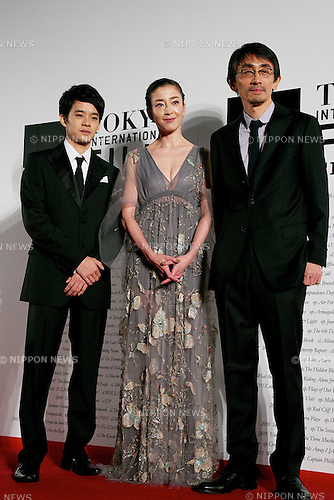 """(L to R) Sousuke Ikematsu, Rie Miyazawa, Daihachi Yoshida, October 23, 2014, Tokyo, Japan : (L to R) Actor Sousuke Ikematsu, Actress Rie Miyazawa and  Daihachi Yoshida Director of the movie """"Pale Moon"""" pose for the cameras at the 27th Tokyo International Film Festival, Opening Event Red Carpet at Roppongi Hills Arena in Tokyo, Japan, October 23, 2014. This year the Prime Minister Shinzo Abe attends the opening ceremony. The Film Festival will run through until Friday 31. (Photo by Rodrigo Reyes Marin/AFLO)"""