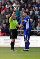 ATTENTION SPORTS PICTURE DESK<br /> Pictured: Match referee K P Stroud (L) showing a yellow card to Leicester City captain Matt Oakley (R)<br /> Re: Npower Championship, Swansea City Football Club v Leicester City at the Liberty Stadium, Swansea, south Wales. Saturday 23 October 2010