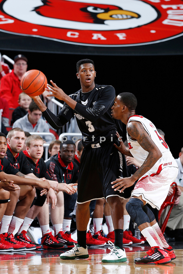 LOUISVILLE, KY - JANUARY 2: Kris Dunn #3 of the Providence Friars passes the ball against the Louisville Cardinals during the game at KFC Yum! Center on January 2, 2013 in Louisville, Kentucky. Louisville won 80-62. Kris Dunn