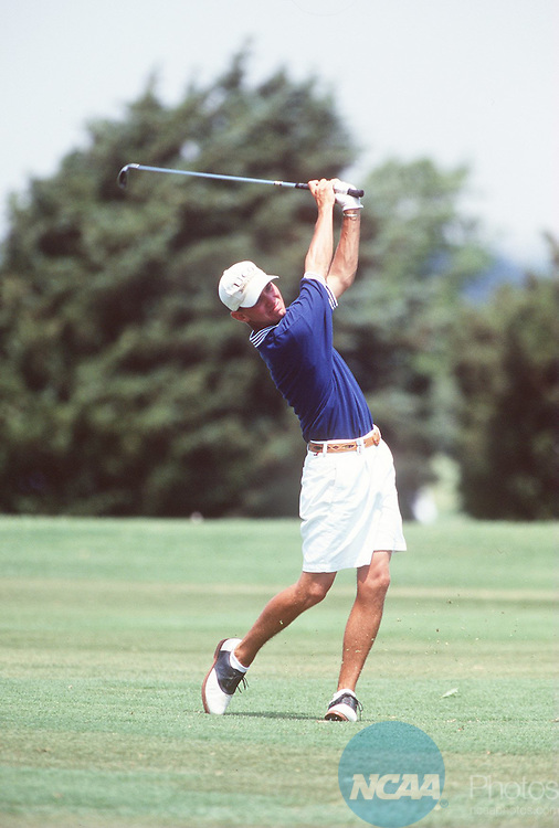 Caption: 24 MAY 1996: Dak Johnson of Central Oklahoma University tees off during the Division 2 Men's Golf Championship hosted by Central Oklahoma State University at the Oak Tree Country Club in Edmond, OK. Johnson took first place in the event with a total score of 291. Lisa Rudy Hoke/NCAA Photos.