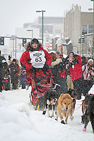 Braxton Peterson leaves the 2011 Iditarod ceremonial start line in downtown Anchorage, during the 2012 Iditarod..Jim R. Kohl/Iditarodphotos.com