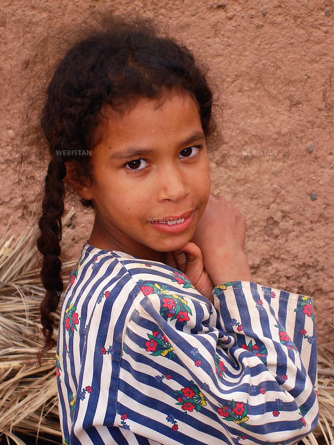2006. Morocco. Portrait of a girl. Maroc. Portrait d'une fille.