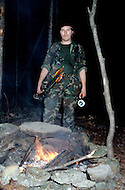 Region of Huntsville, AL - December 6th and 7th 1980<br /> There's a camp of Special Forces of the KKK, members of the Secret Army training. <br /> We are a small group of journalists invited to witness their training Deep in a forest of Alabama, bordering Tennessee, training ground for the Ku Klux Klan&rsquo;s secret army R&eacute;gion de Huntsville, Alabama. 6 et 7 d&eacute;cembre 1980.<br /> Nous sommes un petit groupe de journalistes invit&eacute;s &agrave; un entra&icirc;nement des troupes arm&eacute;es du Ku Klux Klan. On nous a band&eacute; les yeux et nous avons d&ucirc; passer une nuit dans la for&ecirc;t pour assister au petit matin &agrave; un exercice militaire et de tirs d'un groupe arm&eacute; et cagoul&eacute;. On nous a dit que dans cet &eacute;tat ils avaient le droit d'avoir des armes et de s'entra&icirc;ner, non pas &agrave; tuer mais &agrave; d&eacute;fendre la culture de la race blanche.
