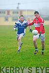 Daingean Uí Chúis Pól Ó Géibheannaigh in possession of the ball closely watched by Annascaul Colm Barry during the West Kerry Senior Final at Lios Poil GAA Grounds in Sunday afternoon.