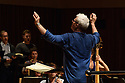 "Saffron Walden, UK. 08.10.2017. English Touring Opera, rehearse onstage, before performing Bach's ""Mass in B Minor"", at Saffron Hall, Saffron Walden, Cambridgeshire. Picture shows: Jonathan Peter Kenny, conductor. Photograph © Jane Hobson."