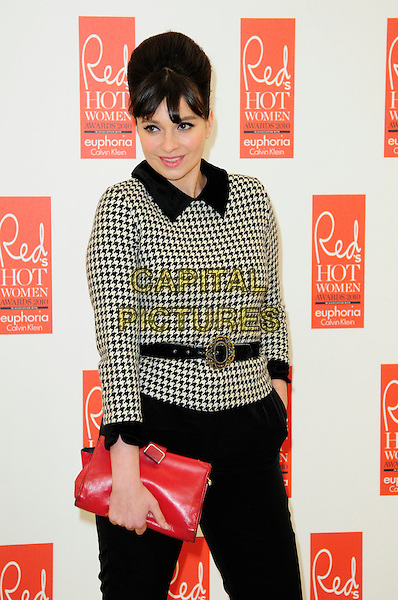 GIZZI ERSKINE .attends Red magazine's 'Red Hot Women Awards' at the Saatchi Gallery, London, England, UK, .November 30th 2010..half length black and white houndstooth jacket top belt collar fringe red clutch bag sixties .CAP/CAS.©Bob Cass/Capital Pictures.