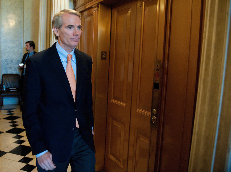 UNITED STATES - JULY 30: Sen. Rob Portman, R-Ohio, leaves the Senate floor as the debate over the debt ceiling crisis continues on Saturday afternoon, July 30, 2011. (Photo By Bill Clark/Roll Call)