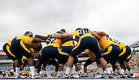 WVU defensive linemen. The WVU Mountaineers defeated the East Carolina Pirates 35-20 at Mountaineer Field at Milan Puskar Stadium, Morgantown, West Virginia on September 12, 2009.