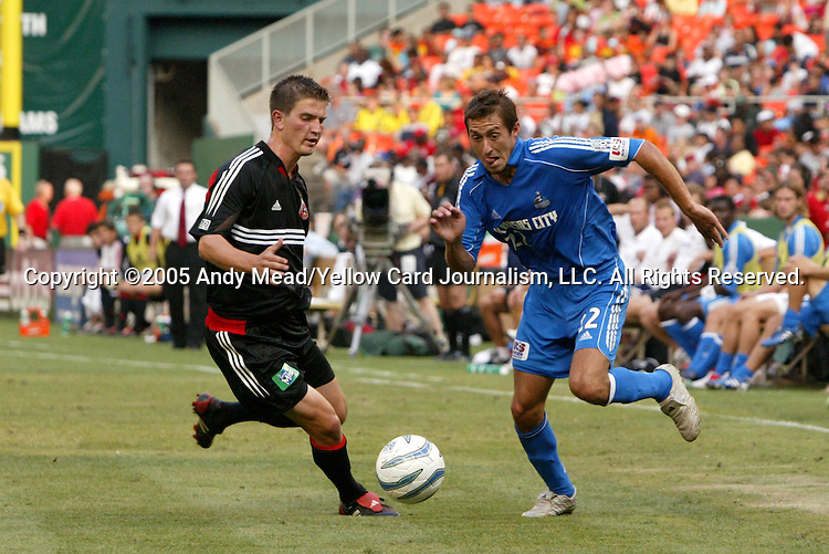 9 July 2005: Davy Arnaud (22) tries to get past Bobby Boswell (l). The Kansas City Wizards defeated DC United 1-0 at RFK Stadium in Washington, DC in a regular season Major League Soccer game. .