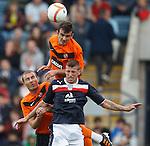 Iain Davidson of Dundee with Gavin Gunning (top) and Shaun Dillon of Dundee Utd