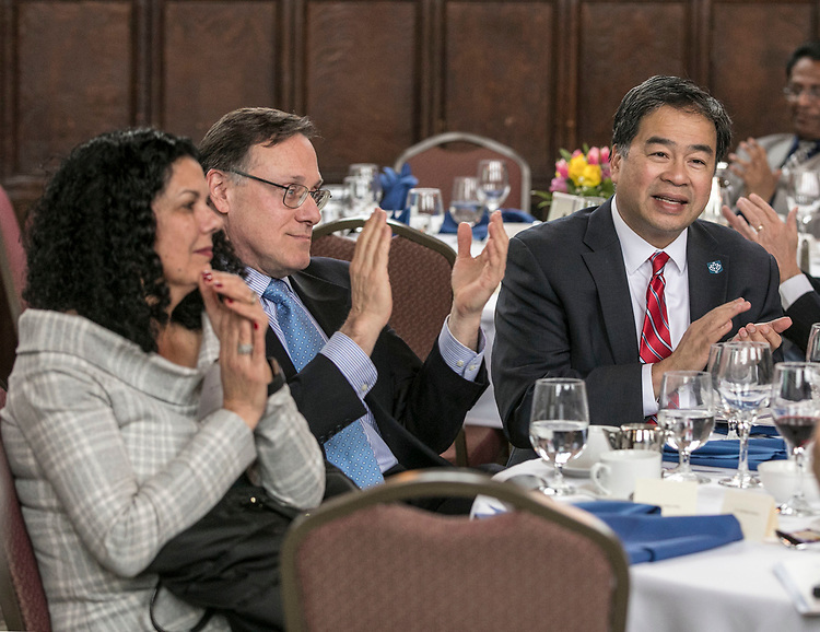 Salma Ghanem, dean of the College of Communication and Edwin Eisendrath, CEO of the Chicago Sun Times, join DePaul University President A. Gabriel Esteban, Ph.D., as they thank the guests following the 13th Annual Consular Corps Luncheon, Tuesday, April 3, 2018, on DePaul's Lincoln Park Campus. The event brings together members of the international consulate community with university staff and faculty in an effort to promote partnerships and educational programs. (DePaul University/Jamie Moncrief)