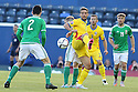 Romania's Alexandru Maxim is tackled from behind by Northern Ireland' Steven Davis during the UEFA EURO 2016 qualifying Group F soccer match between Northern Ireland and Romania at Windsor Park in Belfast, Northern Ireland, 13 June 2015.  EPA/PauL McErlane