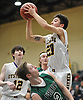 Devon Marmorale #20 of Oyster Bay, right, looks to drive to the hoop as Luke Caliendo #2 of Carle Place attempts to draw a charge during the Nassau County varsity boys basketball Class B semifinals at Farmingdale State College on Sunday, Feb. 18, 2018. Oyster Bay won by a score of 68-52.
