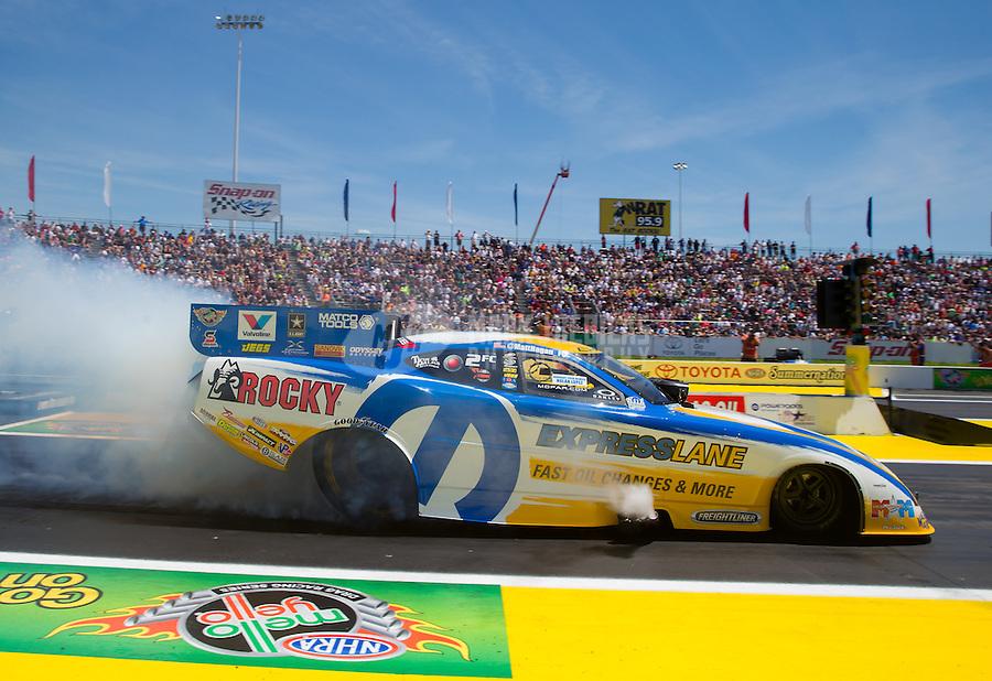 Jun. 1, 2014; Englishtown, NJ, USA; NHRA funny car driver Matt Hagan during the Summernationals at Raceway Park. Mandatory Credit: Mark J. Rebilas-