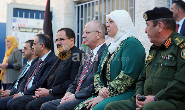 Palestinian Prime Minister Rami Hamdallah visits a school during the first day of the new school year in the West Bank city of Ramallah, on August 28, 2016. Photo by Prime Minister Office