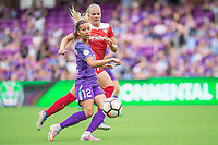 Orlando, FL - Saturday April 22, 2017: Kristen Edmonds, Line Sigvardsen-Jensen during a regular season National Women's Soccer League (NWSL) match between the Orlando Pride and the Washington Spirit at Orlando City Stadium.