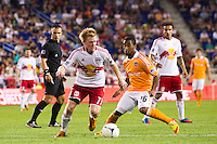 Dax McCarty (11) of the New York Red Bulls is marked by Corey Ashe (26) of the Houston Dynamo. The New York Red Bulls defeated the Houston Dynamo 2-0 during a Major League Soccer (MLS) match at Red Bull Arena in Harrison, NJ, on August 10, 2012.