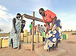 Margaret Dure (right) pumps water from a well constructed by the United Methodist Committee on Relief (UMCOR) in the Southern Sudanese town of Yei. NOTE: In July 2011, Southern Sudan became the independent country of South Sudan