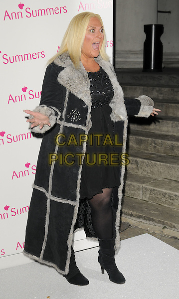 VANESSA FELTZ.The Ann Summers Enchantment Collection launch party, The Baccarat Room, 1 Marylebone Rd., London, England..December 1st, 2008.anne full length dress black tights coat jacket grey gray fur trim lining hands mouth open funny face .CAP/CAN.©Can Nguyen/Capital Pictures.