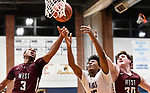 Belleville West players Tommie Williams (left) and Tommy Grafe (right) and Collinsville forward David Granger leap for a rebound. Belleville West played Collinsville in the Class 4A Belleville East regional basketball championship game at Belleville East High School in Belleville, Illinois on Friday March 6, 2020. <br /> Tim Vizer/Special to STLhighschoolsports.com