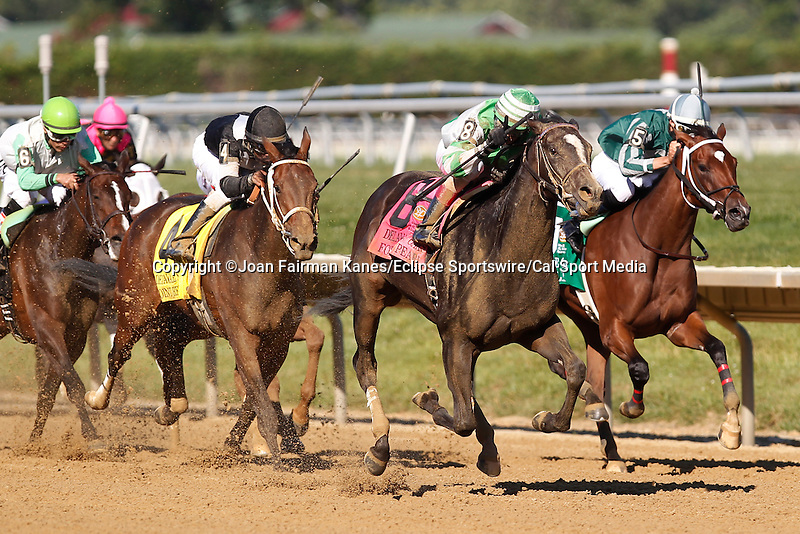 July 5, 2014: Fortune Pearl (#8), Trevor McCarthy up, reaches the front of the pack in the final furlong to win the Grade II Delaware Oalks, one and 1/16 miles, at Delaware Park in Stanton Delaware. She is trained by Graham Motion and owned by Lawrence Stable Inc. #4 Joint Return (left), ridden by Kendrick Carmouche and trained by John Servis, finished second. @ Joan Fairman Kanes/ESW/CSM
