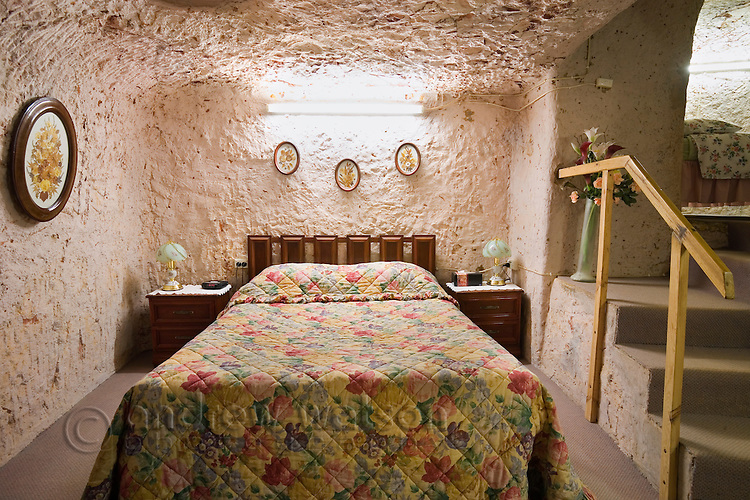 Bedroom in Faye's underground home.  The famous home was built by three pioneering women in the 1960s using pick and shovel.  Coober Pedy, South Australia, AUSTRALIA.
