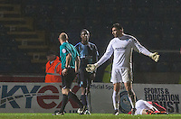 Goalkeeper Matt Ingram of Wycombe Wanderers asks referee A Davies why he has received a red card during the Sky Bet League 2 match between Wycombe Wanderers and Morecambe at Adams Park, High Wycombe, England on 2 January 2016. Photo by Andy Rowland / PRiME Media Images