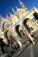 Crowds and tourists moving in front of the Famous St Marks Church in San Marcos Plaza in romantic Venice Ital