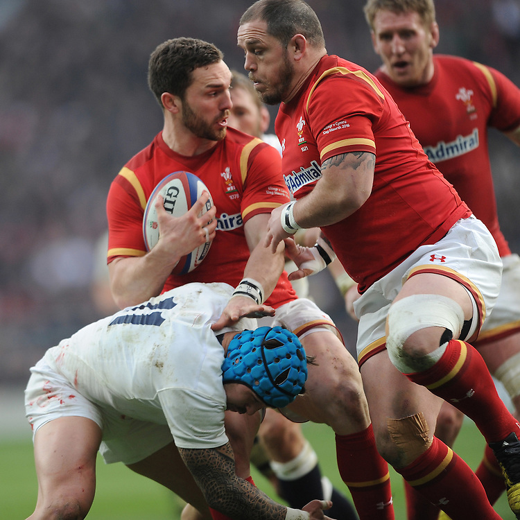 George North of Wales hands off Jack Nowell of England as Ken Owens of Wales supports during the RBS 6 Nations match between England and Wales at Twickenham Stadium on Saturday 12th March 2016 (Photo: Rob Munro/Stewart Communications)