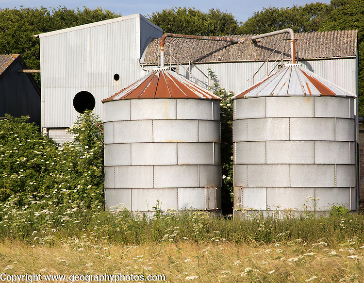 Old steel storage tanks and barns, West Kennet, Wiltshire, England, UK