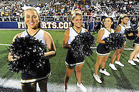 12 November 2011:  FIU's cheerleaders wait to welcome the team to the field prior to the game.  The FIU Golden Panthers defeated the Florida Atlantic University Owls, 41-7, to win the annual Shula Bowl game, at FIU Stadium in Miami, Florida.