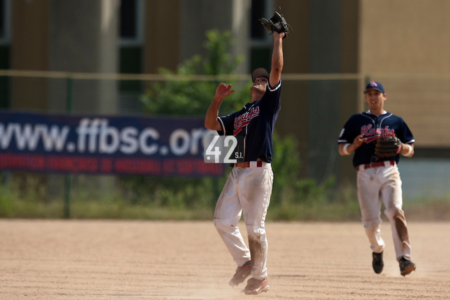 23 May 2009: Virgile Roux of La Guerche catches the ball during the 2009 challenge de France, a tournament with the best French baseball teams - all eight elite league clubs - to determine a spot in the European Cup next year, at Montpellier, France. Rouen wins 6-2 over La Guerche.