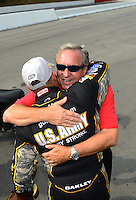 Jun. 17, 2012; Bristol, TN, USA: NHRA top fuel dragster driver Tony Schumacher celebrates with his father and team owner Don Schumacher after winning the Thunder Valley Nationals at Bristol Dragway. Mandatory Credit: Mark J. Rebilas-