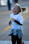 Images of the Start and Finish Line at the Quad Cities Marathon in 2010. This important sporting event is growing each year. These photographs show the intensity as well as the fun of this athletic event.