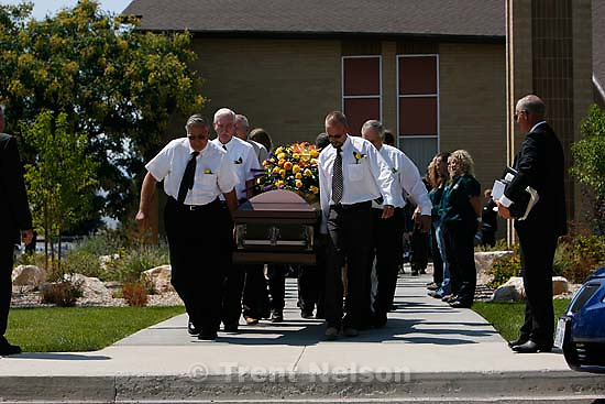 "Salina - Pallbearers carry the casket at the funeral for Gary ""Gibb"" Jensen, held at the Salina LDS Stake Center. Jensen was killed with two others in the rescue and recovery operation at the Crandall Canyon Mine, where six men remain trapped.; 8.22.2007"