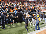 Oklahoma State Cowboys fans rush the field after the game between the Oklahoma Sooners and the Oklahoma State Cowboys at the Boone Pickens Stadium in Stillwater, OK. Oklahoma State defeats Oklahoma 44 to 10..