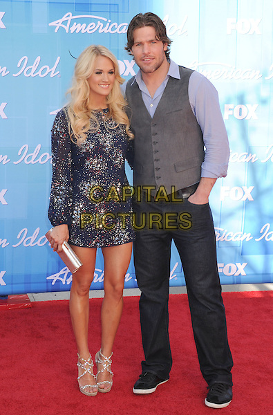 Carrie Underwood, Mike Fisher.American Idol Season 11 Finale - Arrivals held at Nokia Theatre LA Live, Los Angeles, California, USA..May 23rd, 2012.full length dress purple beads beaded embellished jewel encrusted jeans denim grey gray waistcoat .CAP/ROT/TM.©Tony Michaels/Roth Stock/Capital Pictures