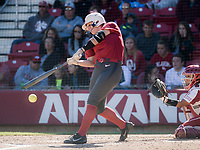 NWA Democrat-Gazette/CHARLIE KAIJO An Arkansas Razorbacks player contacts the ball during a softball match, Sunday, October 28, 2018 at Bogle Park, University of Arkansas in Fayetteville.<br />