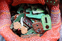 Small circuit boards in a bag in a village near Kolkata whose residents recycle E-Waste.<br />