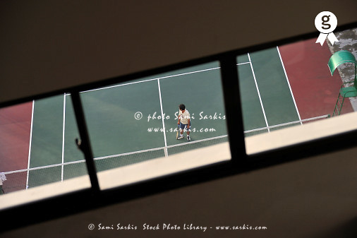 Tennis player on court through window (Licence this image exclusively with Getty: http://www.gettyimages.com/detail/83154241 )