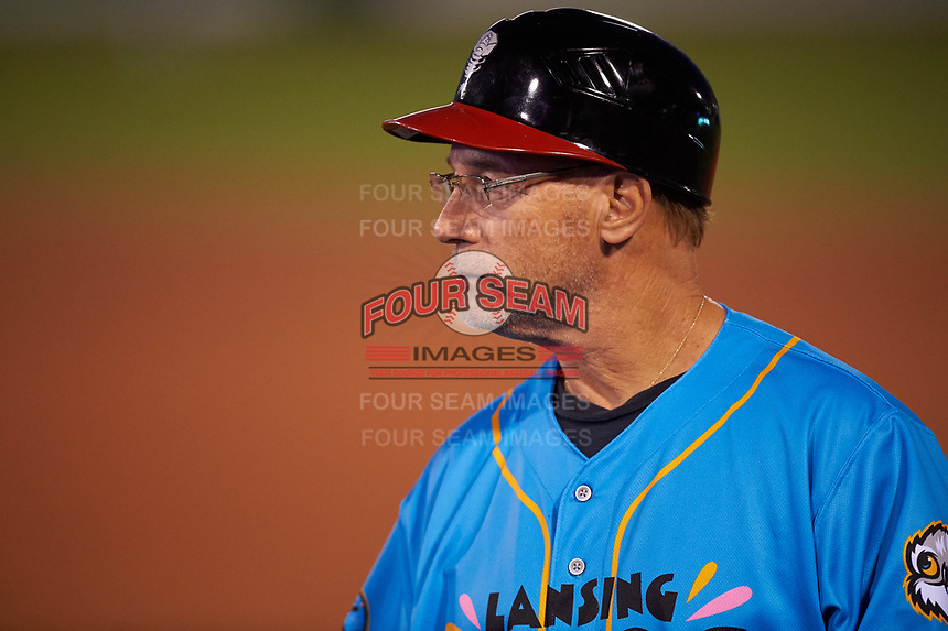 Lansing Lugnuts position coach Dave Pano (13) coaches first base during a Midwest League game against the Beloit Snappers at Cooley Law School Stadium on May 4, 2019 in Lansing, Michigan. The Lugnuts wore their Copa de la Diversión jerseys, becoming the Lansing Locos for the evening. Beloit defeated Lansing 2-1. (Zachary Lucy/Four Seam Images)