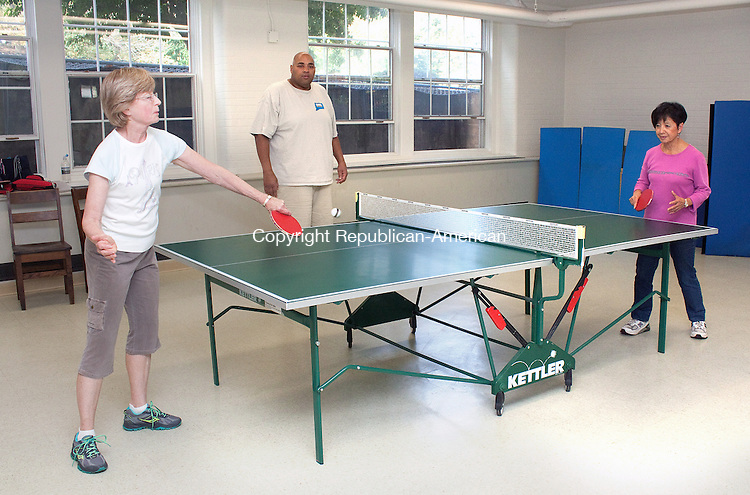 MIDDLEBURY CT.-OCTOBER 9 2013 100913DA01- Mary Odonnell, left, of Middlebury plays a game of ping-pong against Gracie Baldovi, right of Wolcott as they are coached by Rene Cunningham of Woodbury at the Shepardson Community Center in Middlebury on Wednesday. The group are members of the Tribury Table Tennis Club of Middlebury, Southbury and Woodbury. The club is looking for new members at any skill level, paddles available or bring your own. Meet other ping-pong enthusiasts and have fun while exercising your mind and body. For more information you may contact Middlebury Park and Recreation 203-598-3719, Southbury Senior Center 203-264-5858, or the Woodbury Senior Center 203-263-2828.<br /> Darlene Douty Republican American