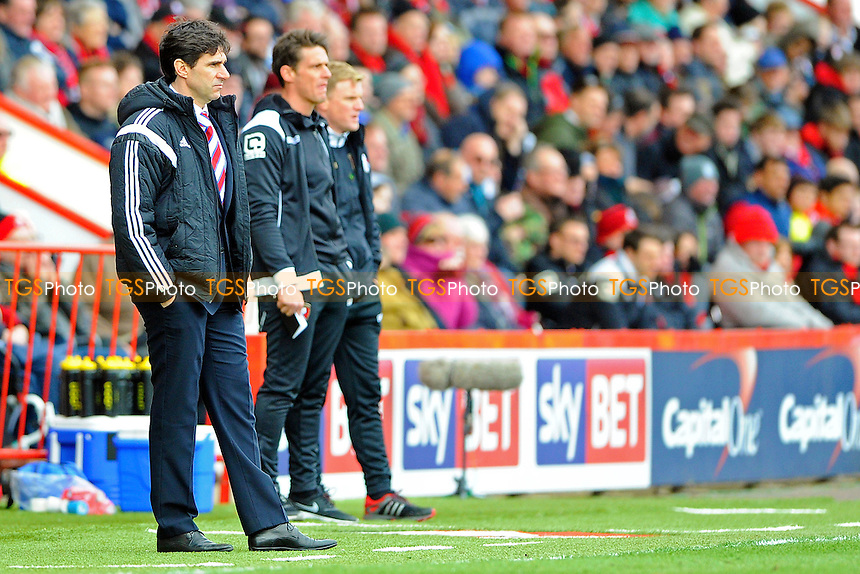 Middlesbrough Manager Altor Karanka left watches on with AFC Bournemouth Assistant Manager Jason Tindall and AFC Bournemouth Manager Eddie Howe in the background - AFC Bournemouth vs Middlesbrough - Sky Bet Championship Football at the Goldsands Stadium, Bournemouth, Dorset - 21/03/15 - MANDATORY CREDIT: Denis Murphy/TGSPHOTO - Self billing applies where appropriate - contact@tgsphoto.co.uk - NO UNPAID USE