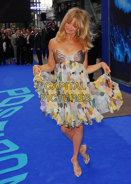 "GOLDIE HAWN .At the UK Film Premiere of ""Poseidon"", .Empire Leicester Square, London, .May 28th 2006..full length sunglasses armpit print patterned babydoll chiffon satin dress funny holding skirt dress curtsey.Ref: CAN.www.capitalpictures.com.sales@capitalpictures.com.©Can Nguyen/Capital Pictures"