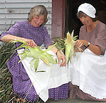 Braintree Historical Society's members Gail Burns and Rosemarie Bonani peals corn during the Braintree Historical Society's annual Heritage Day, at the Thayer House and Museum on Sunday September 21 2014.(Photo by Gary Wilcox)