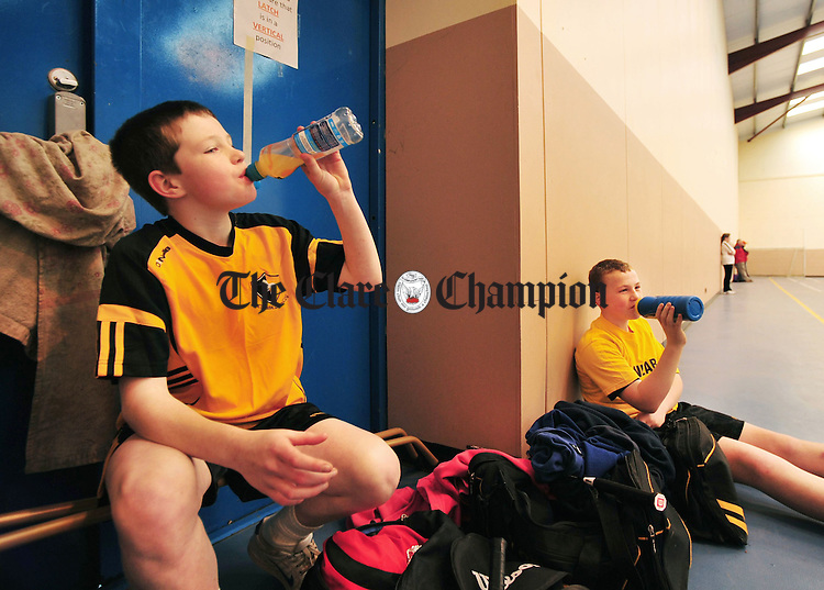 Cian Moriarty and David Fitzgerald from Clonlara taking a break during the Community Games badminton finals in Cratloe. Photograph by Declan Monaghan