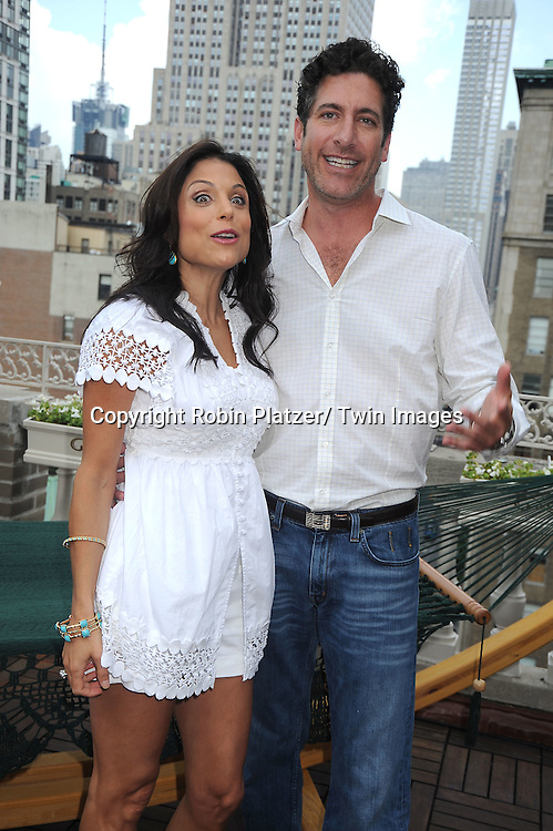 Bethenny Frankel and Eduardo Xol at the Childhelp and Hayneedle.com event at the Midtown LOft and Terrace in New York City on July 21, 2010.  July 22 is national Hammocks Day.