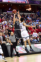 Washington, DC - MAR 11, 2018: Davidson Wildcats guard Kellan Grady (31) hits a fade away jumper over Rhode Island Rams guard Jeff Dowtin (11) during the Atlantic 10 men's basketball championship between Davidson and Rhode Island at the Capital One Arena in Washington, DC. (Photo by Phil Peters/Media Images International)